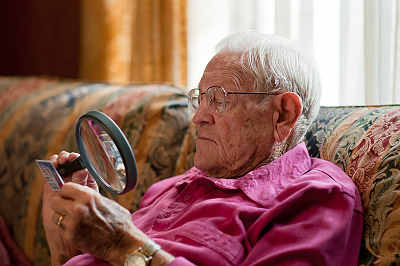 elderly man happily aging at home
