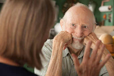 elderly man talking to home care social worker