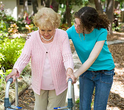 elderly woman helped by a home care aide