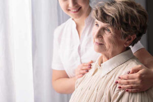 elderly woman with her home care aide